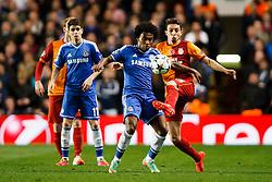 Chelsea Midfielder Willian (BRA) is challenged by Galatasaray Defender Alex Telles (BRA) - Photo mandatory by-line: Rogan Thomson/JMP - 18/03/2014 - SPORT - FOOTBALL - Stamford Bridge, London - Chelsea v Galatasaray - UEFA Champions League Round of 16 Second leg.