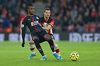 Football - 2019 / 2020 Premier League - Southampton vs. Crystal Palace<br /> <br /> Southampton's Cedric Soares shuts down Wilfried Zaha of Crystal Palace during the Premier League match at St Mary's Stadium Southampton <br /> <br /> COLORSPORT/SHAUN BOGGUST