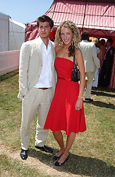 KATE MELHUISH and JACK FREUD at the Veuve Clicquot sponsored Gold Cup Final or the British Open Polo Championship held at Cowdray Park, West Sussex on 17th July 2005.<br />