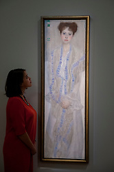 """© Licensed to London News Pictures. 19/06/2015. London, UK. A Sotheby's staff member looks at Gustav Klimt's """"Bildnis Gertud Loew"""" (est. £12m - £18m), at Sotheby's Impressionist, Modern & Contemporary Art preview, ahead of the sale on 24 June 2015. Leading the sale are Kazimir Malevich's, """"Suprematism, 18th Construction"""" and Edouard Manet's """"Le Bar aux Folies-Bergère"""".  Photo credit : Stephen Chung/LNP"""