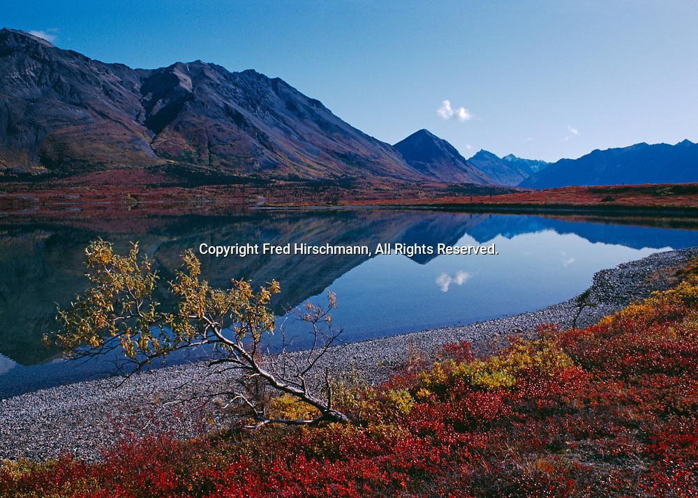Autumn reflection of Black Mountain and Falls Peak in Lake Trout Bay of Lower Twin Lake, Lake Clark National Park, Alaska.