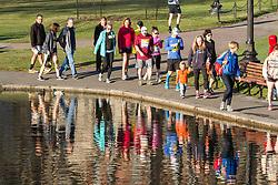 Boston Marathon: BAA 5K road race, runners on way to start line in Boston Common