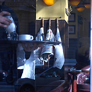 man serving coffee in a parisian cafe