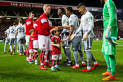 Bristol City mascot greets Marcos Rojo of Manchester United as Hordur Magnusson greets Anthony Martial of Manchester United - Rogan/JMP - 20/12/2017 - Ashton Gate Stadium - Bristol, England - Bristol City v Manchester United - Carabao Cup Quarter Final.