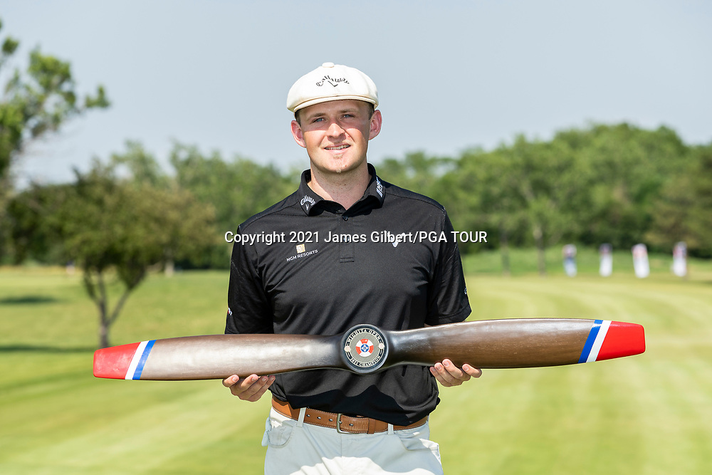 WICHITA, KS - JUNE 20: Harry Hall of England poses with the trophy after wining the Wichita Open Benefitting KU Wichita Pediatrics at Crestview Country Club on June 20, 2021 in Wichita, Kansas. (Photo by James Gilbert/PGA TOUR via Getty Images)