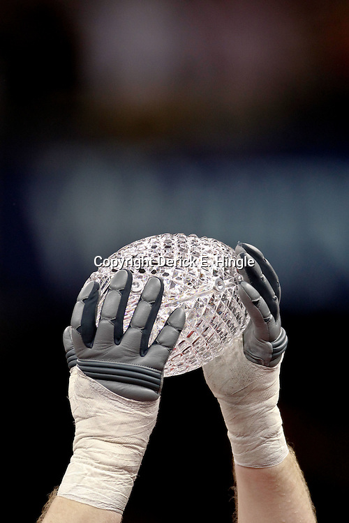 Jan 9, 2012; New Orleans, LA, USA; A Alabama Crimson Tide player raises  The Coaches Trophy crystal football in celebration after the 2012 BCS National Championship game win over the LSU Tigers at the Mercedes-Benz Superdome.  Mandatory Credit: Derick E. Hingle-US PRESSWIRE
