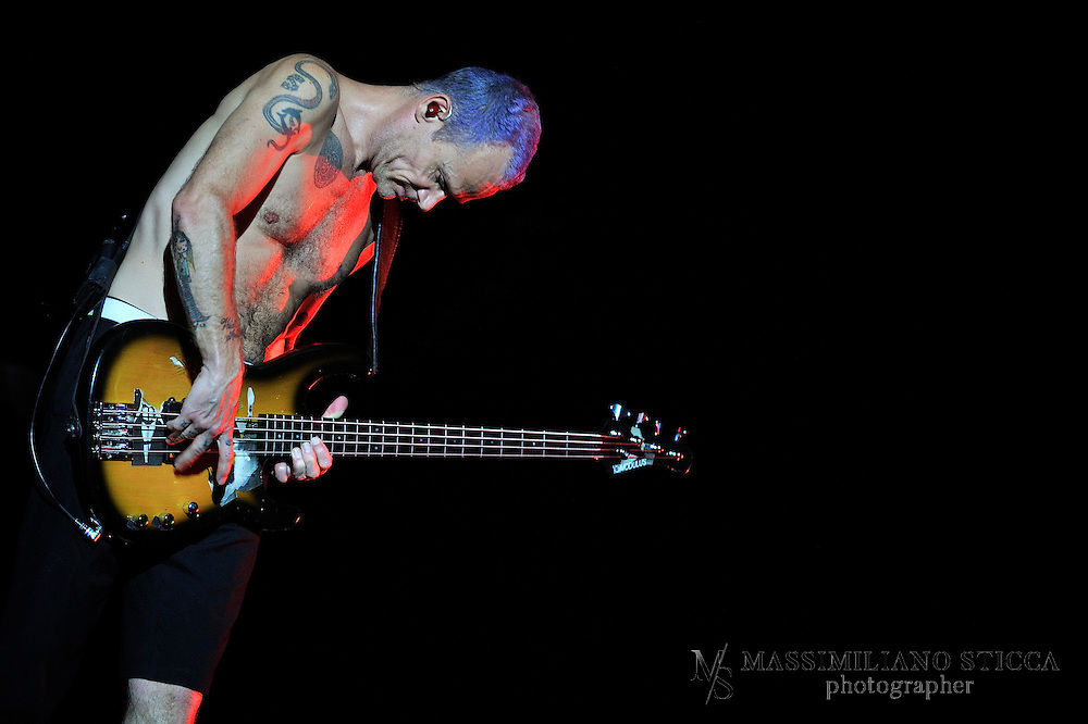"""Red Hot Chili Peppers (also commonly known as the """"Chili Peppers"""" or abbreviated as RHCP) are an American rock band formed in Los Angeles in 1983. The group's musical style primarily consists of rock with an emphasis on funk, as well as elements from other genres such as punk rock and psychedelic rock. When played live, they incorporate many aspects of jam band due to the improvised nature of much of their performances. Currently, the band consists of founding members Anthony Kiedis (vocals) and Michael """"Flea"""" Balzary (bass), longtime drummer Chad Smith, and guitarist Josh Klinghoffer, who joined in late 2009, following the departure of John Frusciante. Red Hot Chili Peppers have won seven Grammy Awards, and sold over 80 million records worldwide"""