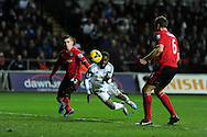 Swansea city's Nathan Dyer (c) scores his sides 2nd goal with a header.. Barclays Premier league, Swansea city v Cardiff city match at the Liberty Stadium in Swansea, South Wales on Saturday 8th Feb 2014.<br /> pic by Andrew Orchard, Andrew Orchard sports photography.
