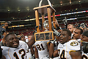 September 05 2009     Missouri's Sean Weatherspoon (12, left) and Derrick Washington (24, right) hold aloft the State Farm Arch Rivalry trophy after they defeated the University of Illinois 37-9.  The University of Missouri hosted the University of Illinois in the annual Arch Rivalry Football Game at the Edward Jones Dome in downtown St. Louis on September 5, 2009. ..            *******EDITORIAL USE ONLY*******