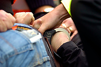 Photo: Alan Crowhurst.<br />Portsmouth v West Ham United. The Barclays Premiership. 14/10/2006. The handcuffs are used..