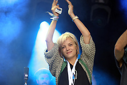 © Licensed to London News Pictures. 26/06/2015. PILTON, UK Glastonbury Festival 2015. Lily Allen joins Rudimental on Park Stage  at a Charity Event Drumming for White Ribbon Alliance . Photo credit : Jason Bryant/LNP