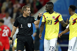 (l-r) referee Mark Geiger, Davinson Sanchez of Colombia during the 2018 FIFA World Cup Russia round of 16 match between Columbia and England at the Spartak stadium  on July 03, 2018 in Moscow, Russia