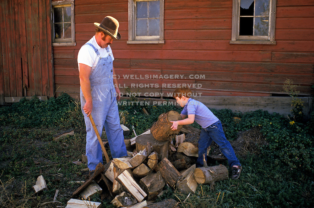 Image of Dick Ferguson and son Reed chop wood in the Palouse, Waitsburg, eastern Washington, Pacific Northwest, model and property released by Randy Wells