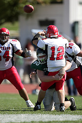 04 October 2008: Max Brooks wraps up Evan Jones in a battle between the Carthage Red Men and the Illinois Wesleyan University Titans, Game action was at Wilder Field on the campus of Illinois Wesleyan University in Bloomington Illinois.