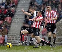 Photo: Jed Wee.<br />Sunderland v Fulham. The Barclays Premiership. 08/04/2006.<br />Fulham's Heidar Helguson (L) is tackled by Sunderland's Tommy Miller.