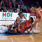 Galatasaray's Melisa CAN (L) and UMMC Ekaterinburg's Yelena LEUCHANKA (R), Candace PARKER (C) during their Euroleague woman Group A basketball match Galatasaray between UMMC Ekaterinburg at the Abdi Ipekci in Istanbul at Turkey on wednesday,October, 26, 2010. Photo by TURKPIX