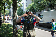 A medical volunteer wearing a gas mask.