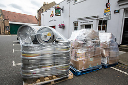 """© Licensed to London News Pictures. 02/07/2020. London, UK. Roll out the Barrels. Workers at Fullers Brewery on the Great West Road, Chiswick load up beer barrels for """"Super Saturday"""" as cafes, restaurants, pubs and hairdressers, prepare for the big opening tomorrow after Prime Minister Boris Johnson gave the go ahead in his statement to the Nation last week. Photo credit: Alex Lentati/LNP"""