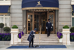 © Licensed to London News Pictures. 17/05/2021. London, UK.  Doorman working outside The Ritz hotel in London as Covid 19 lockdown rules are relaxed from today. Photo credit: Ray Tang/LNP