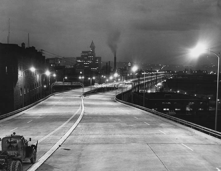 Engineers turned on lights of the Alaskan Way viaduct for the first time. This photograph, looking south along the viaduct's upper deck from a point near Bell Street, shows how the new structure looked at night. (George Carkonen / The Seattle Times)