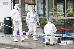 © Licensed to London News Pictures. 10/06/2020. Leatherhead, UK. Police forensics officers at the scene in Leatherhead, Surrey after a body was found. Officers were called to North Street in Leatherhead shortly after 6am this morning following the discovery of a man's body. Enquiries are ongoing at a number of locations in the area. Local reports say that the body may have been found in a block of flats off the High Street. Photo credit: Peter Macdiarmid/LNP