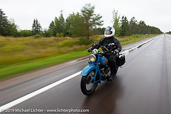 Will Lusignan riding through the rain on his 1936 Indian Sport Scout during the Cross Country Chase motorcycle endurance run from Sault Sainte Marie, MI to Key West, FL. (for vintage bikes from 1930-1948). Stage 1 from Sault Sainte Marie to Ludington, MI USA. Friday, September 6, 2019. Photography ©2019 Michael Lichter.