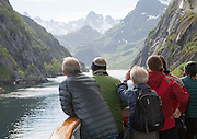 Tourists sightseeing from Hurtugruten ship, Trollfjorden, Lofoten Islands, Nordland, northern, Norway
