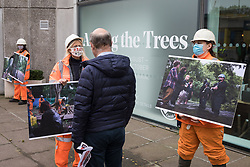 Activists dressed as HS2 workers take part in a HS2 Chainsaw Massacre protest outside the Among The Trees exhibition at the Hayward Gallery on 30 October 2020 in London, United Kingdom. The protest was intended to highlight both the daily environmental destruction being wrought for the controversial HS2 high-speed rail project and instances of violence and brutality by security guards and bailiffs working on behalf of HS2 Ltd.