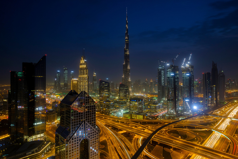 UNITED ARAB EMIRATES, DUBAI - CIRCA JANUARY 2017: Sheikh Zayed Road and Burj Khalifa at night in Dubai. This is the main artery of the city and is home for most of the Dubai skyscrapers.