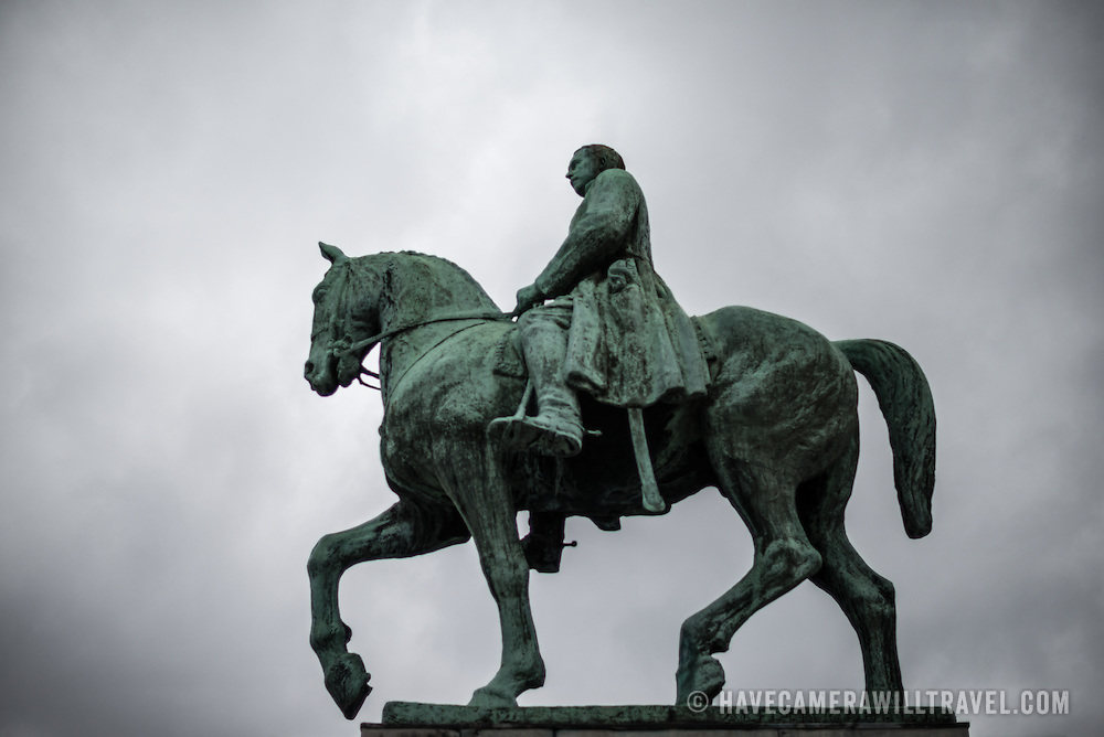 A statue of a mounted Albert I of Belgium (1875-1934) against an overcast sky at the foot of the Mont des Arts in Brussels, Belgium.