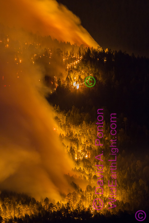 Thompson Fire burning mixed conifer forest on the west side of Redondo Peak on the night of June 1, 2013. Valles Caldera National Preserve, New Mexico, © 2013 David A. Ponton
