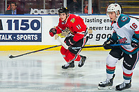 KELOWNA, BC - MARCH 03: Robbie Fromm-Delorme #11 of the Portland Winterhawks and Michael Farren #16 of the Kelowna Rockets skate for the puck at Prospera Place on March 3, 2019 in Kelowna, Canada. (Photo by Marissa Baecker/Getty Images)