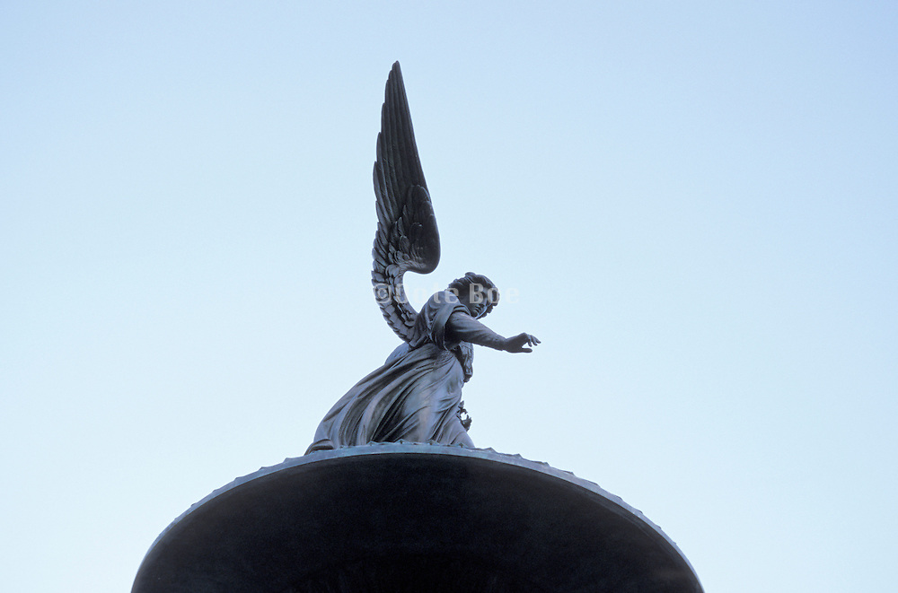angel statue viewed from beneath
