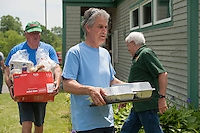 Maurice Chaloux, Brent Beck and Bob Stuart help with the complimentary BBQ following the 70th Anniversary celebration of the Kiwanis Pool in St. Johnsbury Vermont.  Karen Bobotas / for Kiwanis International