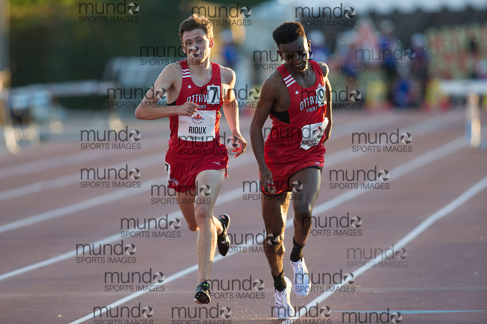 OTTAWA, ON -- 07 July 2018: Jonathan Rioux surges past Andre Alie-Lamarche to take the silver in the U20 3000m steeplechase at the 2018 Athletics Canada National Track and Field Championships held at the Terry Fox Athletics Facility in Ottawa, Canada. (Photo by Sean Burges / Mundo Sport Images).