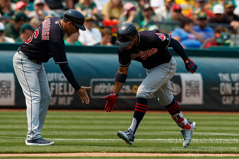 OAKLAND, CA - JULY 01: Francisco Lindor #12 of the Cleveland Indians is congratulated by third base coach Mike Sarbaugh #16 after hitting a home run against the Oakland Athletics during the seventh inning at the Oakland Coliseum on July 1, 2018 in Oakland, California. The Cleveland Indians defeated the Oakland Athletics 15-3. (Photo by Jason O. Watson/Getty Images) *** Local Caption *** Francisco Lindor; Mike Sarbaugh
