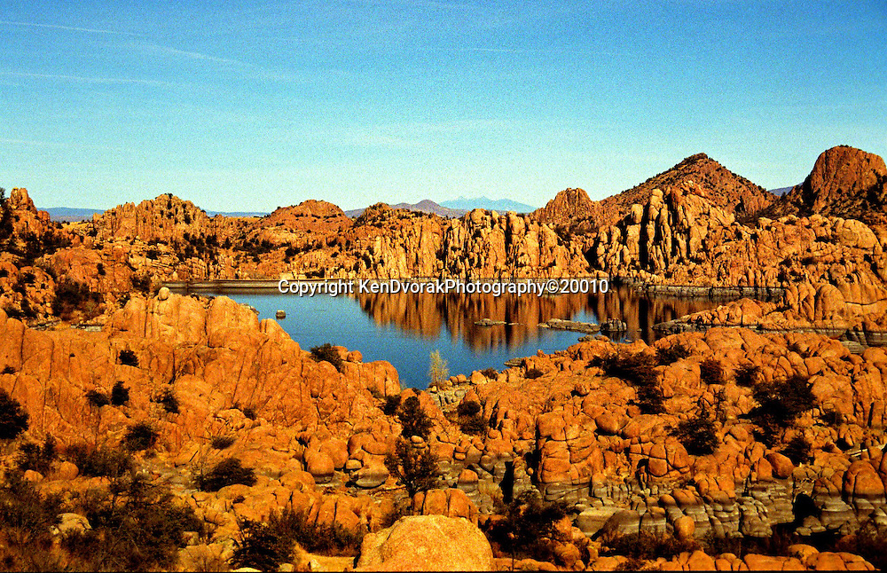 Prescott Lakes include Watson Lake. The early morning light gives a glow to this formation called the Dells.