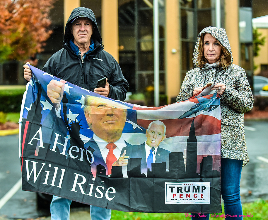 Trump supporters along Airport Road wait for Air Force One to land. Air Force One lands at Lehigh Valley International Airport on Monday, October 26, 2020 bringing President Donald Trump to a rally at HoverTech in Hanover Township, Northampton County.