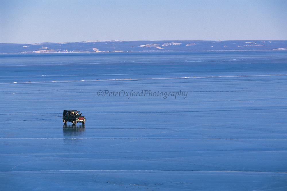 Driving across frozen lake<br /> Lake Hovsgol<br /> Northern Mongolia