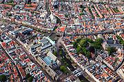 Nederland, Zuid-Holland, Leiden, 15-07-2012; binnenstad Leiden met links van het midden Breestraat (met Stadhuis). Onder in beeld de Nieuwe Rijn met Koornbrug en Vismarkt. midden Stille Rijn en Oude Rijn. Aan de Lange Mare de Hartebrugkerk, in het groen rechts De Burcht..Old town and center of Leiden. Nieuwe Rijn (canal, l), the Burcht (green fortress) and city hall (b).  .luchtfoto (toeslag), aerial photo (additional fee required).foto/photo Siebe Swart