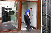 Nederland, the Netherlands, Bemmel, 23-8-2018Een gespecialiseerd schadeherstelbedrijf is bezig met het herstellen van de schade aan het gemeentehuis, stadhuis, van de gemeente Lingewaard na de ontploffing van een gasfles in een auto die eergisternacht door de hoofdingang naar binnen reed. De rookschade en waterschade zijn aanzienlijk. Vloerbedekking moet worden vervangen en elektronische apparatuur gaat naar een bedrijf wat deze schoonmaakt en van roetaanslag ontdoet .Foto: Flip Franssen