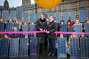 Antoinette Sandbach MP and Tim Loughton MP cut the ribbon for the opening of Westminsters first solar park calling on the government to stop their plans to axe the export tariff on 5th December 2018 in Westminster, London. United Kingdom. The tariff pays small scale solar owners for their excess energy. Climate campaign group 10:10 covered Old Palace Yard outside the House of Commons with dozens of solar panels held by climate activists.