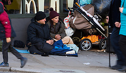 """Tracy, 49, and James, 35 on their pitch outside McDonalds on the High Street, opposite Windsor Castle. After a public outcry against their """"homelessness support strategy"""" where rough sleepers would have been fined £100, Windsor council has shelved their plans. Windsor, Berkshire, February 16 2018."""