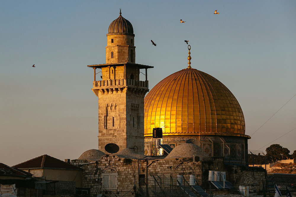 The Dome of the Rock Mosque with its golden cupola, located in the Al-Aqsa Mosque compound in the Old City of Jerusalem.