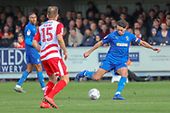 AFC Wimbledon defender Will Nightingale (5) passing the ball during the EFL Sky Bet League 1 match between AFC Wimbledon and Doncaster Rovers at the Cherry Red Records Stadium, Kingston, England on 9 March 2019.
