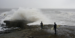 © Licensed to London News Pictures. 21/01/2013..Teesside, England, UK..Surfers wait for a lull in the waves as heavy seas pound the Northeast coast on Teesside...Photo credit : Ian Forsyth/LNP.