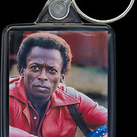 Miles Davis - Key Fob with image approx. 35mm x 50mm from 1970 Isle of Wight Music Festival exhibition on the front. The reverse has an exclusive CameronLife  1970 IW festival design