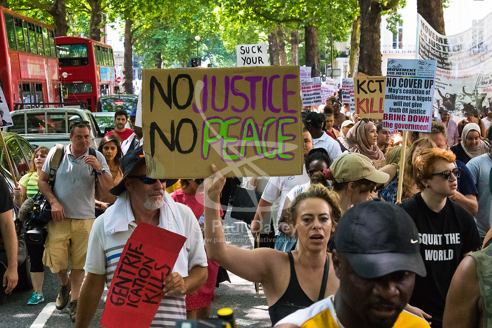 London, June 21st 2017. Protesters march through London from Sheherd's Bush Green in what the organisers call 'A Day Of Rage' in the wake of the Grenfell Tower fire disaster. The march is organised by the Movement for Justice By Any Means Necessary and coincides with the Queen's Speech at Parliament, the destination.