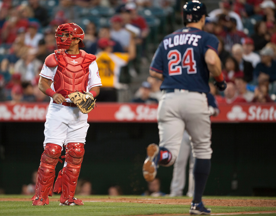 The Angels' Carlos Perez looks on as the Twins' Trevor Plouffe scores after his three-run home run in the third inning Monday at Angel Stadium.<br /> <br /> ///ADDITIONAL INFO:   <br /> <br /> angels.0614.kjs  ---  Photo by KEVIN SULLIVAN / Orange County Register  -- 6/13/16<br /> <br /> The Los Angeles Angels take on the Minnesota Twins Monday at Angel Stadium.