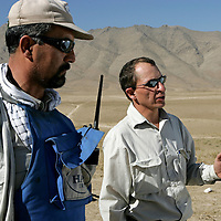 Tom Dibb (right) is Halo Trust's Afghanistan Operations Manager. Afghanistan remains one of the most heavily mined countries in the world. A mine clearance team from the Halo Trust have been working for more than a year in the small village of Kohe Safi and have removed 800 mines and 118 unexploded bombs. Kohe Safi, Afghanistan on the 1st of November 2007..Throughout the country the Halo Trust alone is working to clear 90 million square meters of mine fields containing some 640,000 mines, they estimate it will take them 18 years to complete this task..A break through in mine detection not seen since  World War II is due to speed things up in the coming year when Halo become the first civlilian organisation to use H-STAMIDS (The Handheld Stand-Off Mine Detection System) a new combination tool with a metal detector and ground penetrating radar system. The H-STAMIDS remain classified and during recent trails in Afghanistan the device had to be returned to the US military at the end of each day. The new equipment should make mine clearance 2-3 times faster.